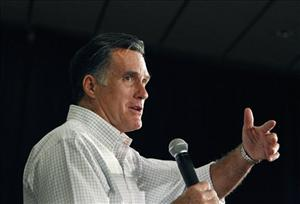 Mitt Romney speaks during a town meeting in Manchester, N.H., Friday.