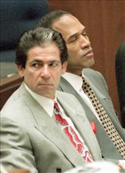 Murder defendant OJ Simpson listens to testimony by the Los Angeles County Coroner 07 June. Next to Simpson is attorney Robert Kardashian.    AFP PHOTO