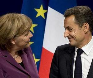 Angela Merkel and Nicolas Sarkozy are seen as they arrive for a press conference after a meeting with George Papandreou and EU and IMF representatives, Nov. 2, 2011.