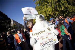 Demonstrators march against the proposed pipeline outside the White House on Nov. 6.