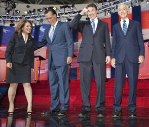 Republican presidential candidates Michelle Bachmann, Mitt Romney, Rick Perry, and Ron Paul pose on September 7, 2011 at the Ronald Reagan Presidential Library in Simi Valley, California.