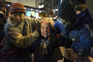 Seattle activist Dorli Rainey, 84, reacts after being hit with pepper spray during an Occupy Seattle protest on Tuesday, Nov. 15, 2011 at Westlake Park in Seattle.