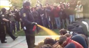 A UC Davis cop pepper-sprays student protesters.