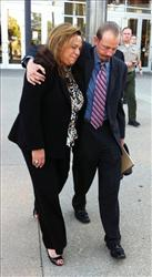 Defense attorney Scott Wippert right, hugs private investigator, Kathryn Lestelle outside court where a mistrial was declared in a gay student murder trial, Sept. 1, 2011 in Chatsworth, Calif.