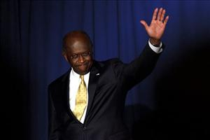 Herman Cain waves to the crowd at Hillsdale College in Hillsdale, Michigan yesterday.