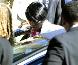 Martina Davis-Correia gets into a car after the funeral of her brother  Troy Davis  in Savannah, Ga., Saturday, Oct. 1, 2011.