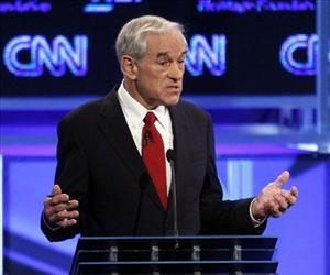 Republican presidential candidate Rep. Ron Paul, R-Texas, speaks at a Republican presidential debate in Washington, Tuesday, Nov. 22, 2011.