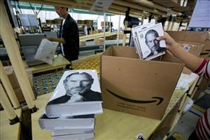 Workers prepare to pack biography books of late Apple founder Steve Jobs for orders at Amazon's Kunshan Order Fulfillment Center in Kunshan city in eastern China's Jiangsu province Nov. 10, 2011.