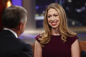 In this image released by NBC, host Brian Williams, left, interviews Chelsea Clinton, daughter of former President Bill Clinton, on Rock Center with Brian Williams, Monday, Dec. 12, 2011  in New York.