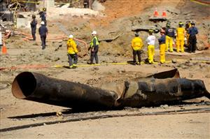 A natural gas line lies broken on a San Bruno, Calif., road on Saturday, Sept. 11, 2010, after a massive explosion that killed eight  people.