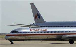 In this June 29, 2011 file photo, an American Airlines aircraft at Dallas-Fort Worth International Airport, in Grapevine, Texas.
