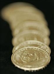 In this Jan. 24, 2007 file photo provided by the US Mint, new Presidential $1 coins are displayed in Chicago.