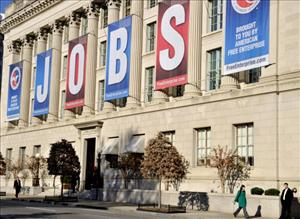 A jobs sign hangs above the entrance to the US Chamber of Commerce building in Washington, DC on December 13, 2011.