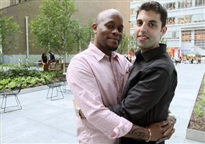 Darren Major, left, and his husband Andrew Troup pose for a photograph Thursday June 30, 2011 in New York.
