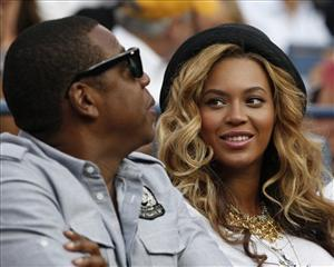 Beyonce Knowles, right, looks at Jay-Z during the men's championship match at the U.S. Open tennis tournament in New York, Monday, Sept. 12, 2011.