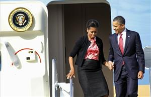 President Barack Obama and first lady Michelle Obama exit Air Force One upon their arrival at Pope Army Field in Fort Bragg, N.C., Wednesday, Dec. 14, 2011.