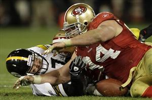 San Francisco 49ers defensive tackle Justin Smith (94) recovers a fumble by Pittsburgh Steelers quarterback Ben Roethlisberger.