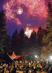 Crowds cheer below Mount Paektu on Kim Jong Il's 67th birthday.