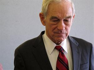 In this photo taken Friday, Oct. 7, 2011, Republican presidential candidate Rep. Ron Paul, R-Texas speaks to media at the airport in Greenville, N.C.