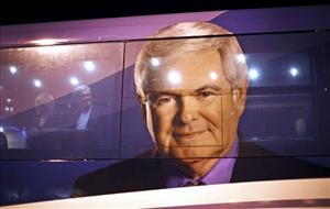 Newt Gingrich and his wife stand inside their campaign bus after making a campaign stop at the National Farm Toy Museum in Dyersville, Iowa, yesterday.