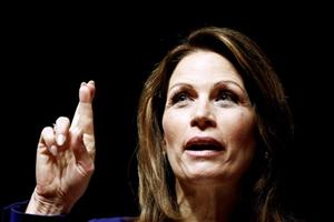 Michele Bachmann gestures while speaking during a campaign stop at Principal Financial Group in Des Moines, Iowa yesterday.