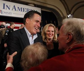 In this Dec. 27, 2011 file photo, Republican presidential candidate, former Massachusetts Gov. Mitt Romney, left, and his wife Ann greet supporters after a campaign stop in Davenport, Iowa.