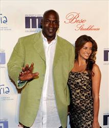 In this photo provided by the Las Vegas News Bureau, Michael Jordan and his girlfriend Yvette Prieto arrive for a celebrity dinner at Beso inside Crystals in City Center Thursday, March 31, 2011.