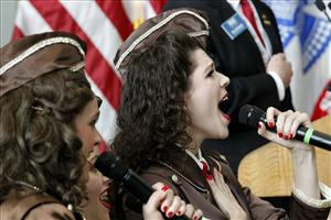 'The Liberty Belles' sing the National Anthem at a ceremony observing the 70th anniversary of the attack on Pearl Harbor, at the National World War II Museum in New Orleans, Wednesday, Dec. 7, 2011.
