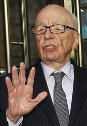 In this July 15, 2011 file photo, Rupert Murdoch attempts to speak to the media after he held a meeting with the parents and sister of murdered school girl Milly Dowler in London.