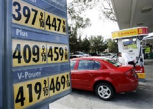 High gas prices are seen posted at a Shell gas station in Menlo Park, Calif.