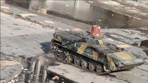 Video grab shows a Syrian tank driving through the city of Homs on December 26, 2011.