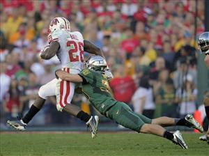 Oregon's John Boyett (20) stops Wisconsin running back, Montee Ball (28) during the second half of the Rose Bowl NCAA college football game, Monday, Jan. 2, 2012, in Pasadena, Calif.