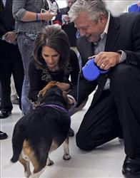 Michele Bachmann and her husband Marcus Bachmann put beads on their dog Boomer before Rep. Bachmann goes on to speak during a rally, at the Blaine Airport in Blaine, Minn., Saturday, Oct. 30, 2010.