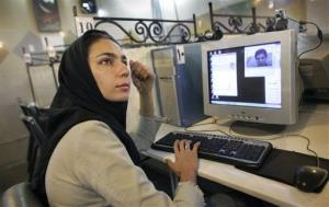 An Iranian woman uses the Internet at a cafe in Tehran.