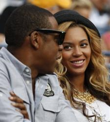 Beyonce Knowles, right, looks at Jay-Z during the men's championship match between Novak Djokovic of Serbia and Rafael Nadal of Spain at the U.S. Open tennis tournament in New York, Sept. 12, 2011.