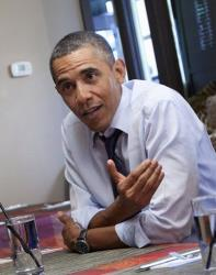 President Barack Obama lunches with supporters Friday, Jan. 6, 2012, at a restaurant in Washington.