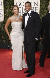 In this Jan. 11, 2009 file photo, Beyonce, left, is joined by husband Jay-Z, as she arrives at the 66th Annual Golden Globe Awards in Beverly Hills, Calif.