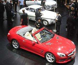 The 2013 Mercedes-Benz SL, foreground, is shown on the floor of the North American International Auto Show in Detroit, Monday, Jan. 9, 2012.