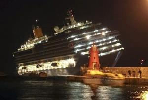 The luxury cruise ship Costa Concordia leans after it ran aground off the coast of Isola del Giglio island, Italy.