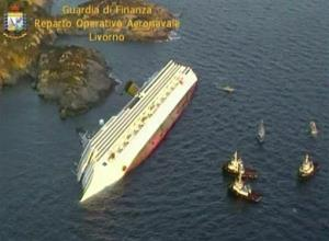 This aerial video image taken from a helicopter shows the luxury ship on its side.