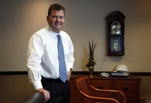 In this Nov. 8, 2011 file photo, Dave Spence poses for a photo in his office in St. Louis.