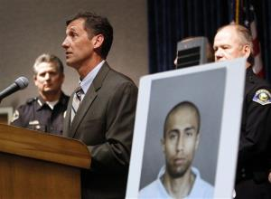 FBI  special agent in charge William O'Leary speaks at the podium before several police chiefs for a news conference to announce the arrest of Itzcoatl Ocampo.