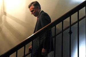 Jon Huntsman descends stairs during an event at Virginia's on King restaurant, Sunday, Jan. 15, 2012, in Charleston, SC.