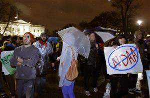 Occupy DC demonstrators chant slogans outside the White House.