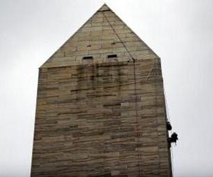 Engineers suspended by ropes conduct a block-by-block inspection of the Washington Monument exterior in Washington, DC, on October 3, 2011.