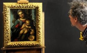 A member of the media takes a closer look at the National Gallery of Victoria's (NGV's) newly acquired painting by Italian Renaissance painter Correggio.