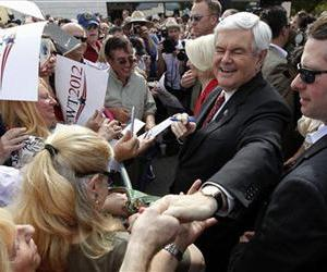 Newt Gingrich,and his wife Callista meet with supporters at Wings Plus Restaurant, Jan. 25, 2012, in Coral Springs, Fla.