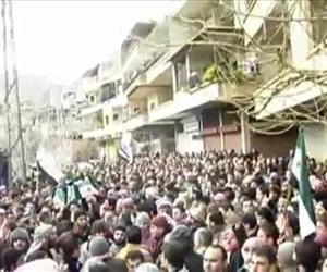 This image from amateur video made available by the Ugarit News group and shot on Sunday, Jan. 29, 2012, purports to show a funeral in Damascus, Syria.
