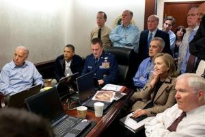 Biden, left, watches the raid from the White House Situation Room.