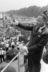 Martin Luther King waves to supporters 28 August 1963 from the Lincoln Memorial on the Mall in Washington DC during the 'March on Washington'.